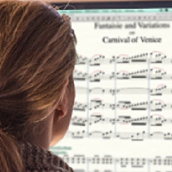 Girl looking at music score on screen