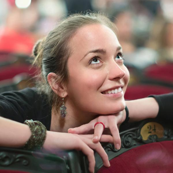 Girl sitting in audience
