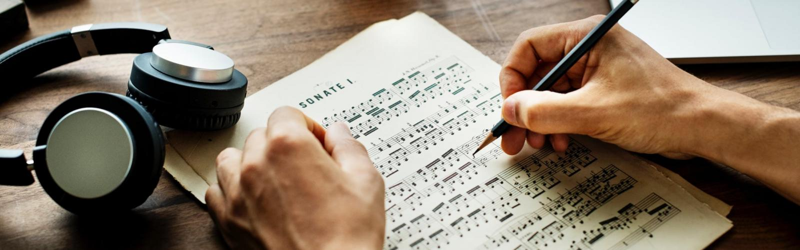 Person Marking up Music Score (Stock Image)